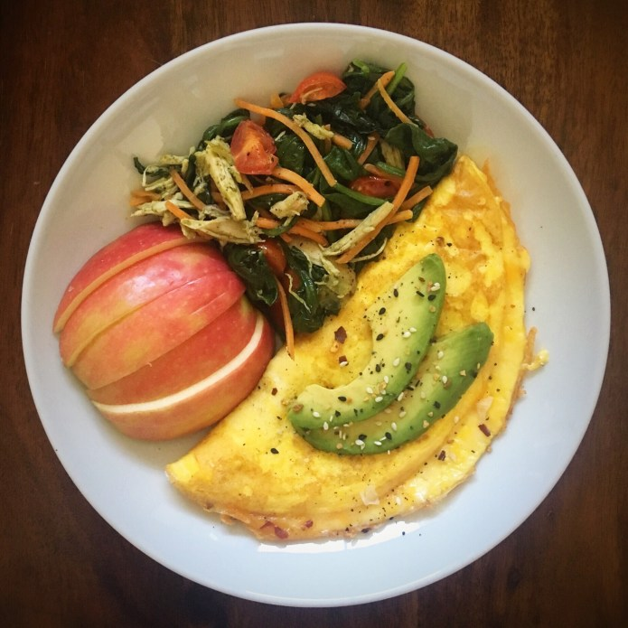 Cheese Omelette with Avocado and a Spinach Salad with Half an Apple