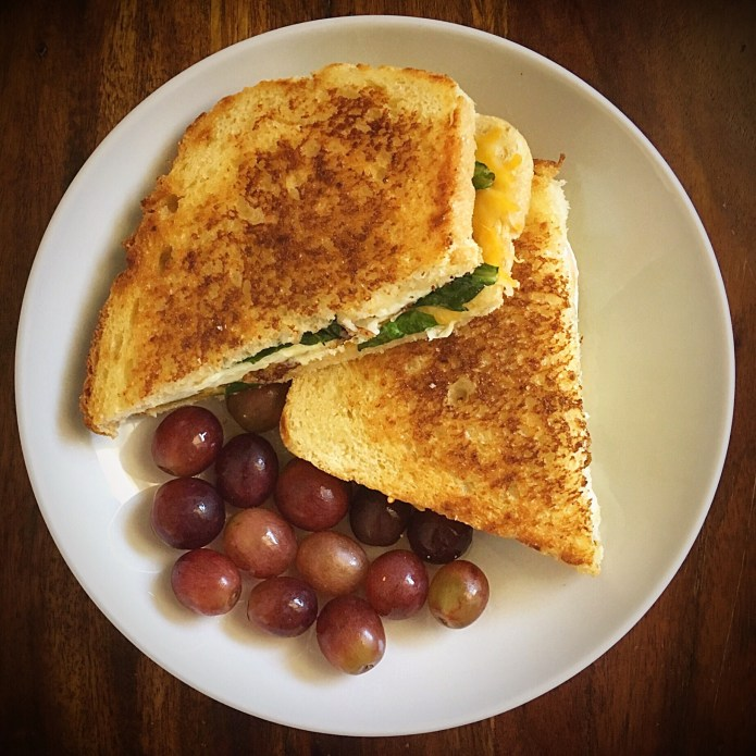 Grilled Cheese Sandwich with Fried Egg and Spinach, and 14 Grapes