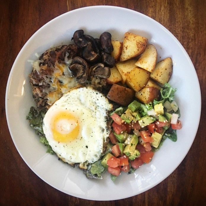 Black Bean Mushroom Burger with Cheese, Mushrooms, Onions, Potatoes, Pico, Avocado, and Fried Egg