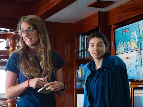 Leigh Marsh and Megan Lubertkin in the Nautilus lounge. Megan is a graduate student at University of Rhode Island's Graduate School of Oceanography. Image Credit: Jenny Woodman