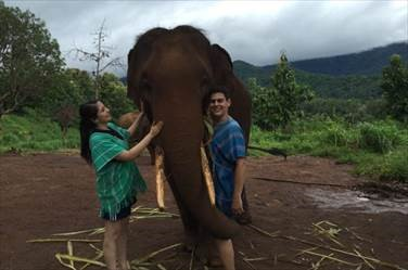 Pictured above is Leo and his wife, Yasmeen, at an elephant sanctuary in Thailand
