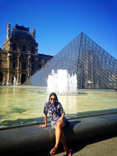 Pictured above is Samantha outside the Louvre in Paris, France