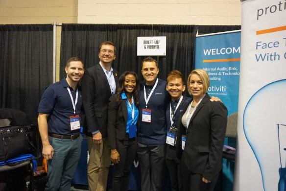 Pictured above is Kizzy with the Protiviti Team!
