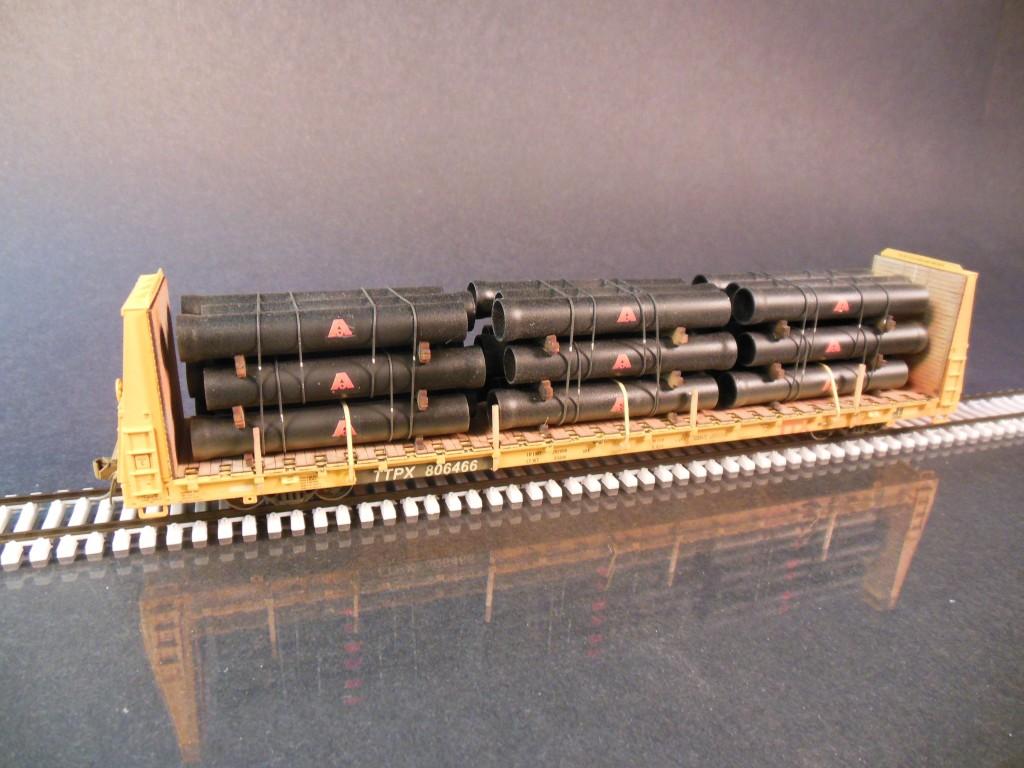 Atlas HO Bulkhead Flatcar With Ductile Iron Pipe. -Protoloads