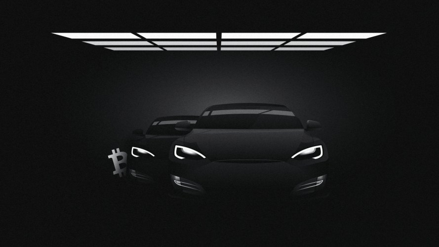 A black and white image of two Tesla cars with a Bitcoin symbol peeping out from behind them