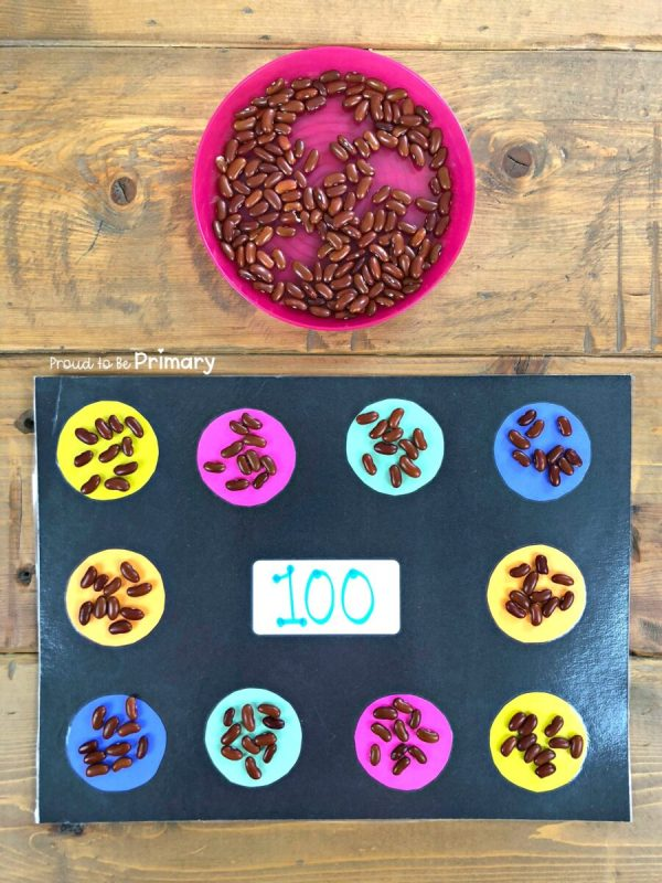 grouping by 10s to 100 on mat with bean counters