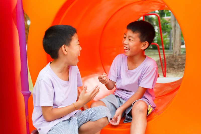 two boys playing rock paper scissors as a brain break game
