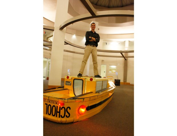 artist Dana Provence standing on the boat