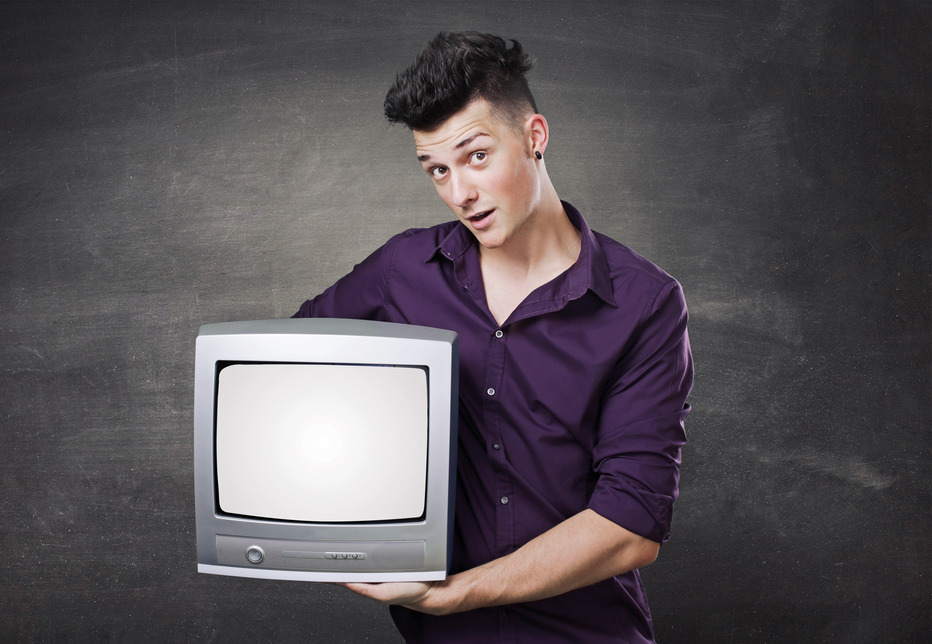 man holding tv with blank screen