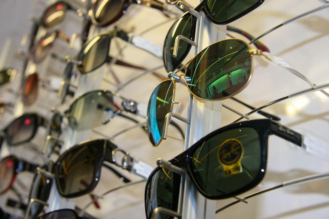 sunglasses on display wall