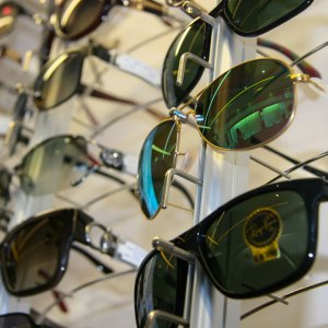 sunglasses on display wall