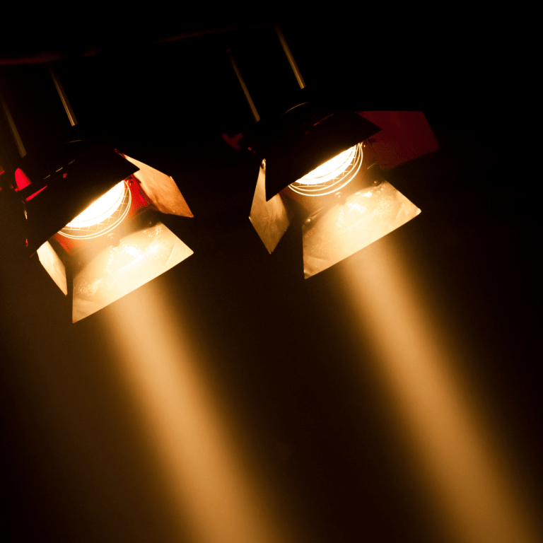 Spotlights pointing at a digital stage of modern economy.