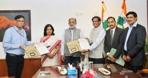 Tourism Minister and Officials post signing ceremony of MoU between Indian Cultural Institute and Indira Gandhi National Tribal University, Amarkhantak, in New Delhi on April 24, 2018. The Secretary, Ministry of Tourism, Smt. Rashmi Verma is also seen.