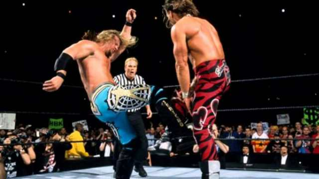 Chris Jericho kicks Shawn Michaels in the groinal region at WrestleMania 19