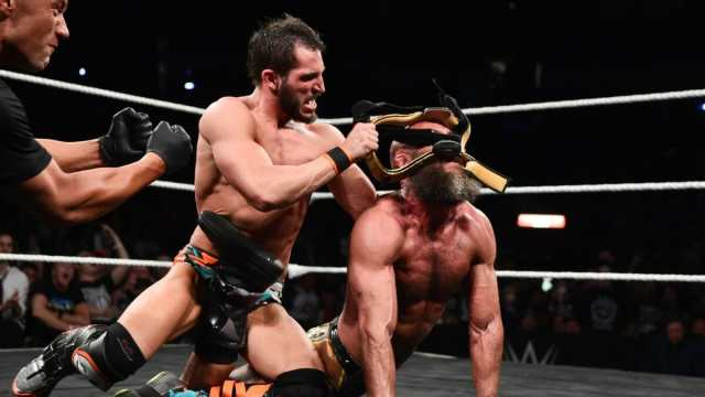 Gargano locks in the Garga-No-Escape with a knee brace wrapped around Ciampa's face and mouth - NXT TakeOver: New Orleans
