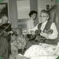 Grandma playing guitar.