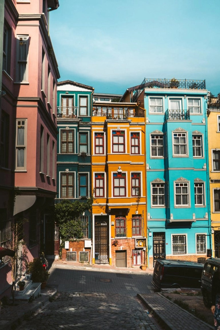 photo of colorful buildings under blue sky