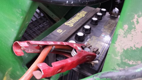 connecting jumper cables to the john deere 950 tractor - poudre river  stables - fort collins