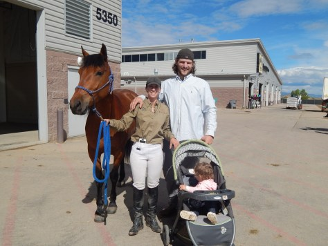 Cayla Stone and family with Calypso the Mustang outside of the Ranchway Arena, Larimer County Fairgrounds, Extreme Mustang Makeover 2015.