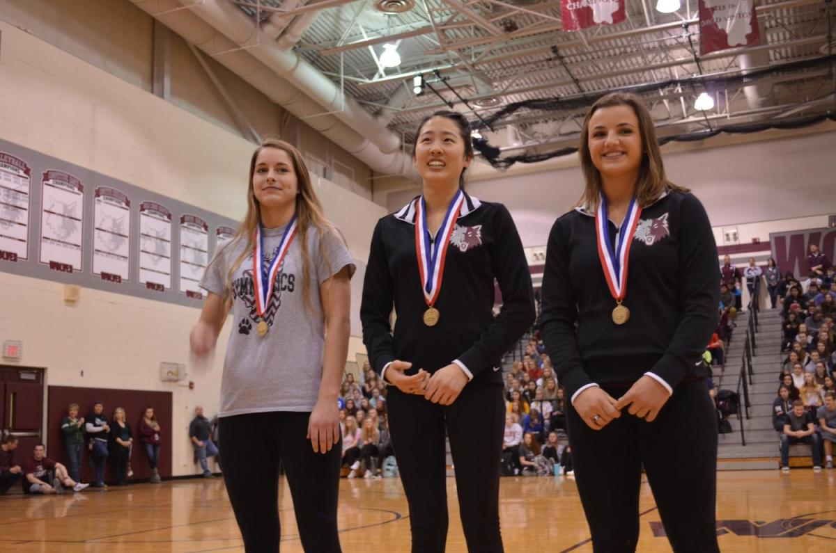 The+Girls%27+Gymnastics+Prairie+Ridge+Co-op+team+dominated+this+year+with+regional%2C+sectional%2C+and+now+a+second+state+championship.+Pictured+here+are+gymnasts+Erinn+Placko%2C+Maddi+Kim%2C+and+%0AKira+Karlblom.