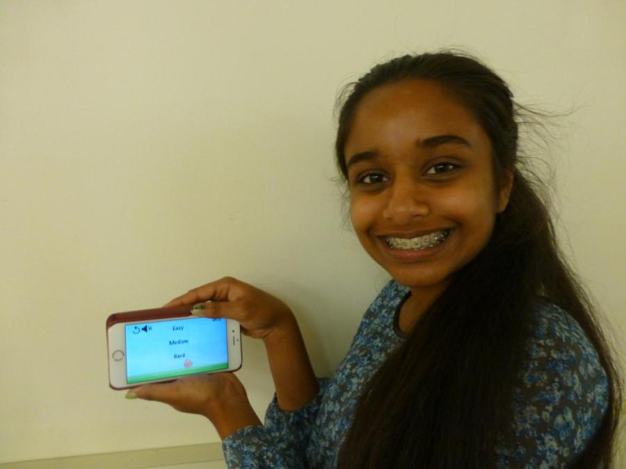 Sophomore+Neha+Konjeti+holds+her+phone+open+to+the+app+Bunny+Hop+she+developed+the+summer+before+her+freshman+year+of+high+school.