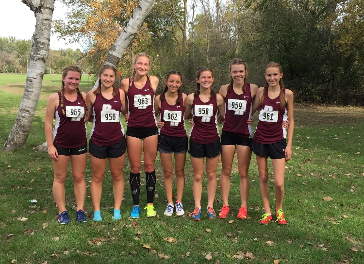 Chelsea+%28third+from+the+right%29+and+the+rest+of+the+girls+XC+team+pose+after+their+regional+race+on+Saturday%2C+October+21st+in+Wilmot+Wisconsin.