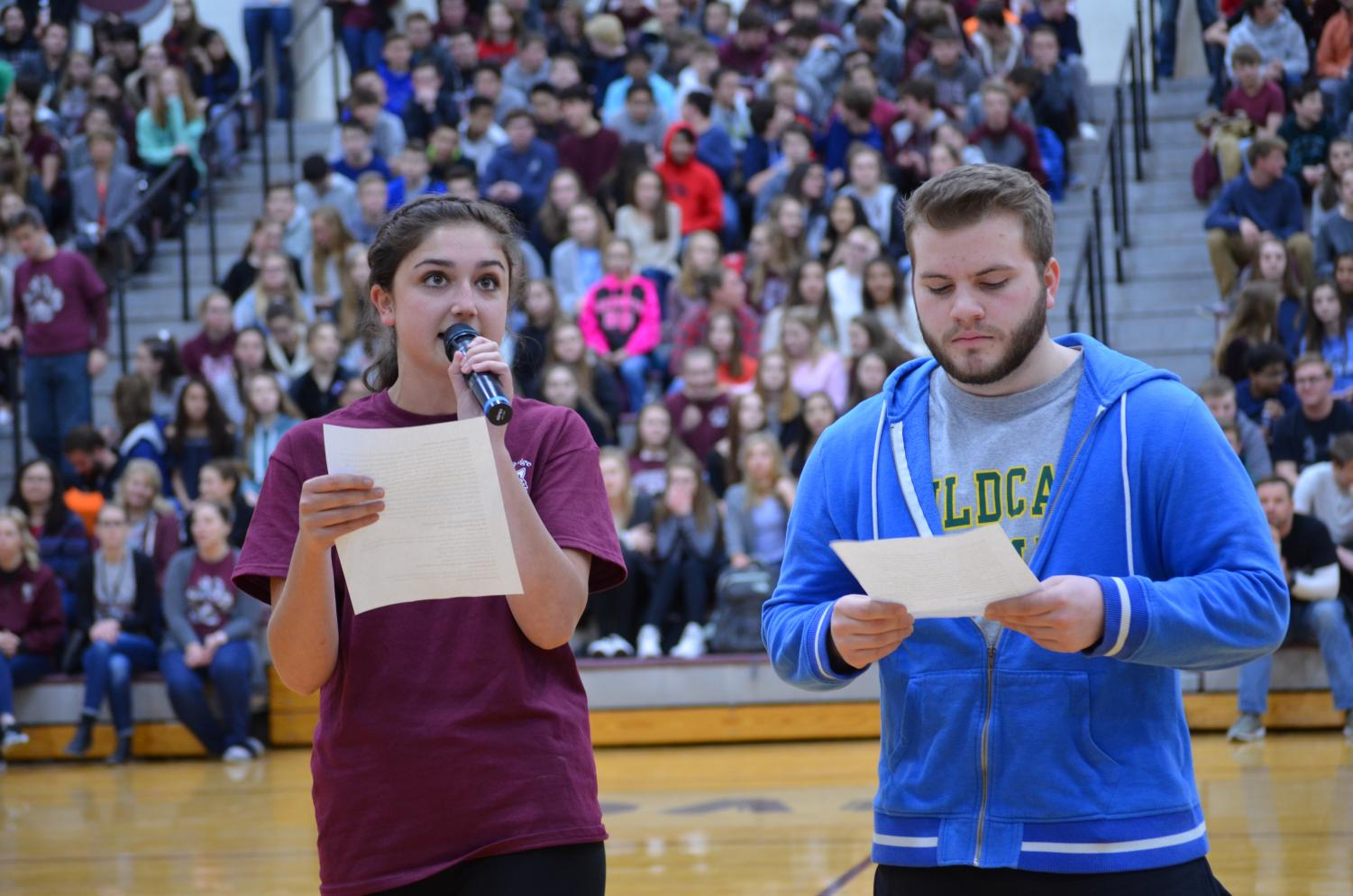 Melina Weil and Nick Falco emcee the spring honors assembly organized by Student Council on Friday, April 6.