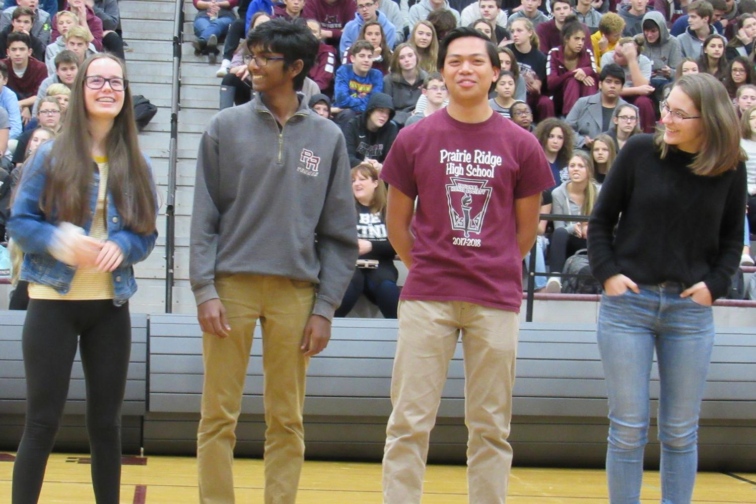 Members of the state champion Science Olympiad team smiled when they were recognized during the assembly on Friday, November 30, 2018.