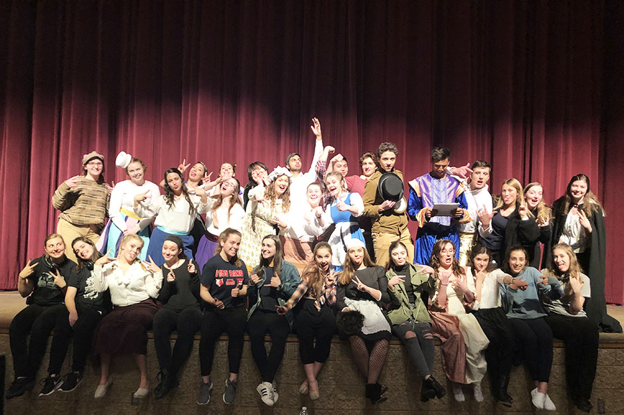The cast and crew of this year's Senior Project musical pose for a silly shot. This year's show raised $1,000 for breast cancer research.