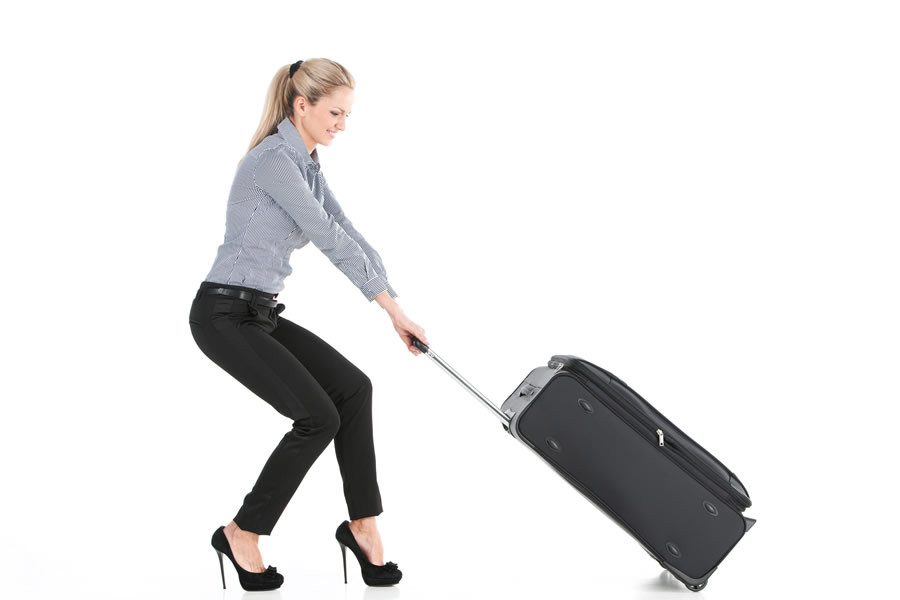 business-traveller-woman-with-black-suitcase