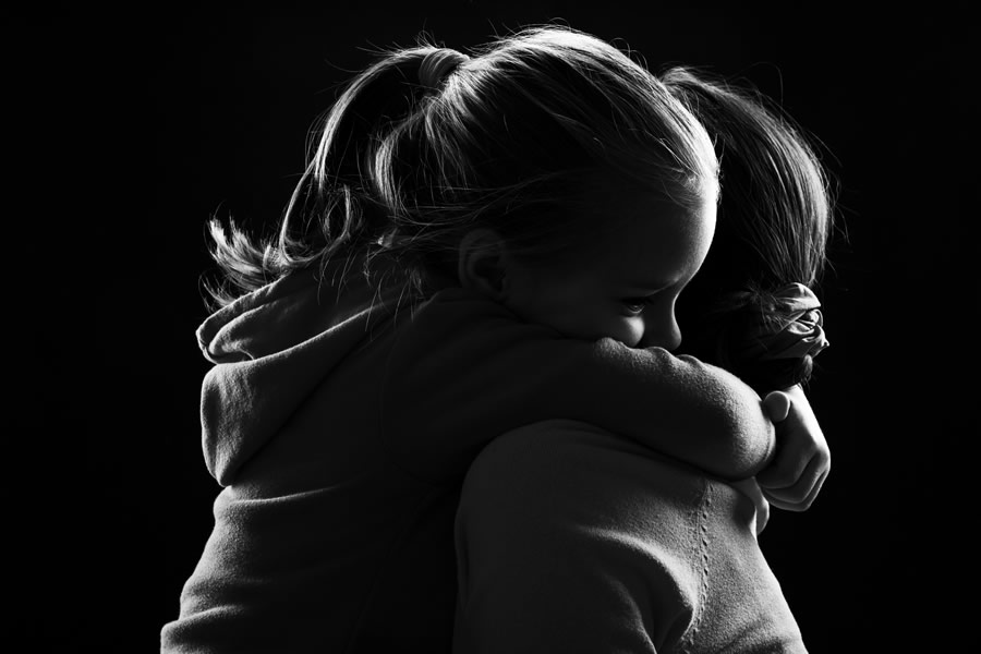 divorce-young-girl-hugging-mother