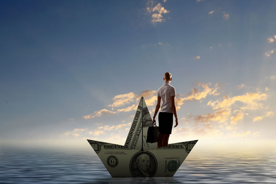 money-stories-businesswoman-escapes-from-crisis-on-paper-boat-made-of-dollar-banknote