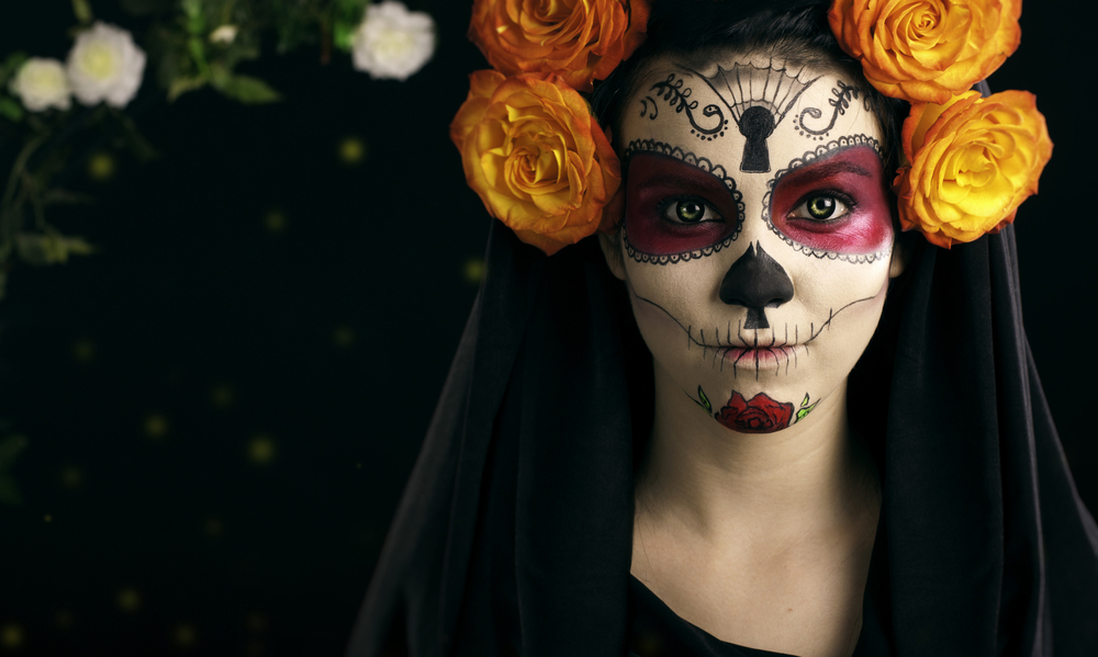 Day of the Dead - Creative face paint portrait flower .Day of the Dead persons.halloween