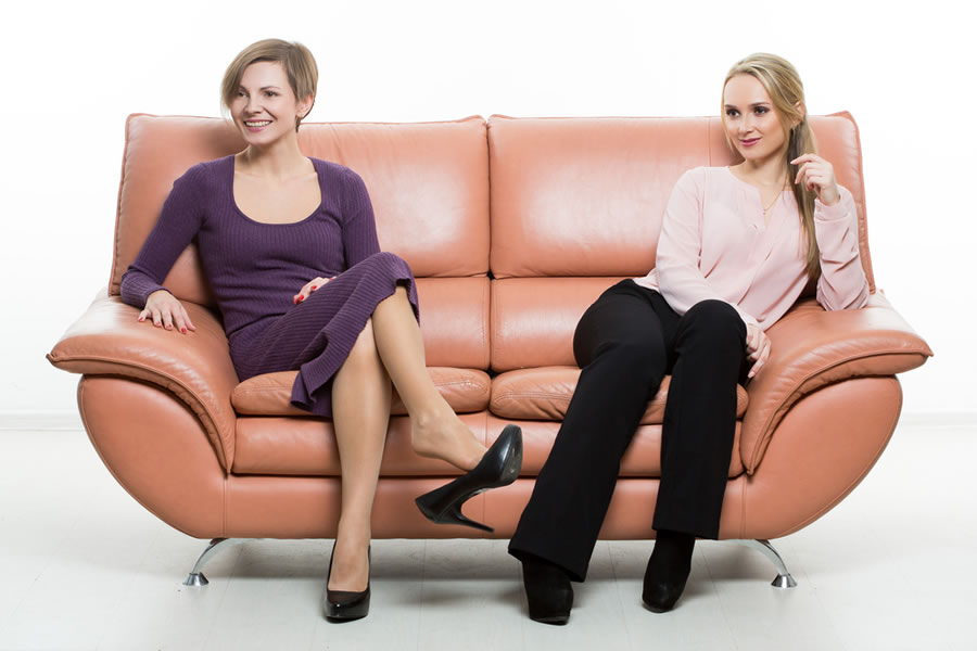 Power - two-women-sitting-on-couch-with-body-language