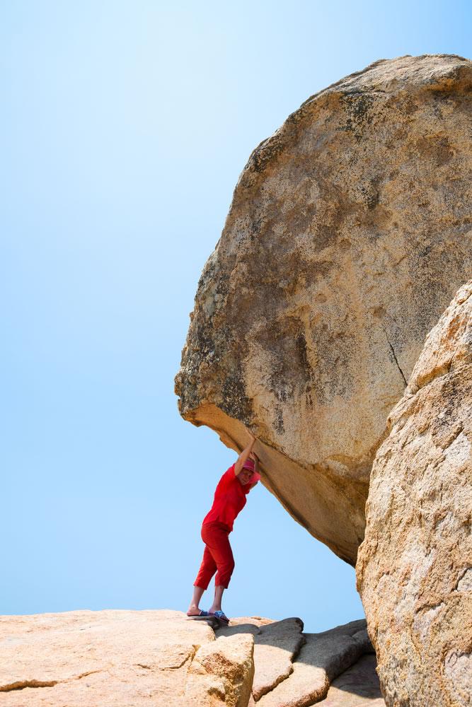 Power - woman-pushing-rock