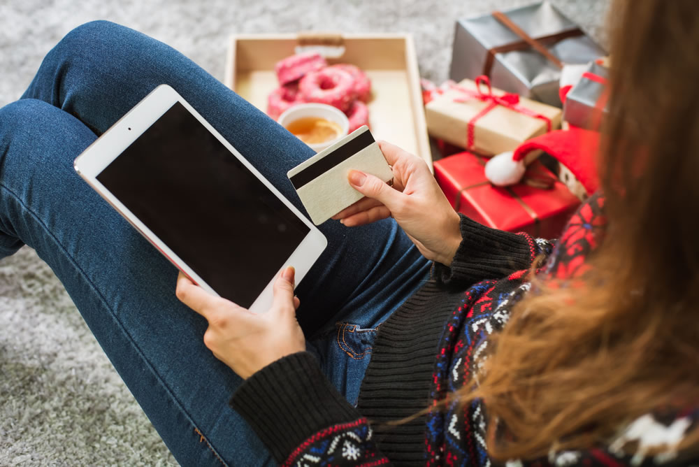 Holiday Spending - woman with laptop and credit card