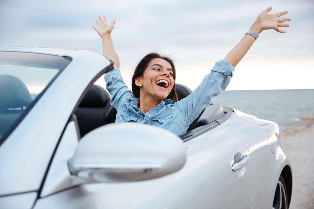 money and happiness woman in white car