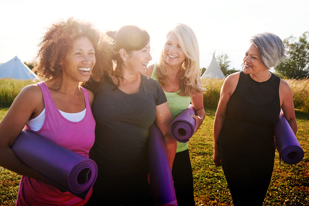 Money can't buy happiness - group of women with yoga mats and healthy lifestyle