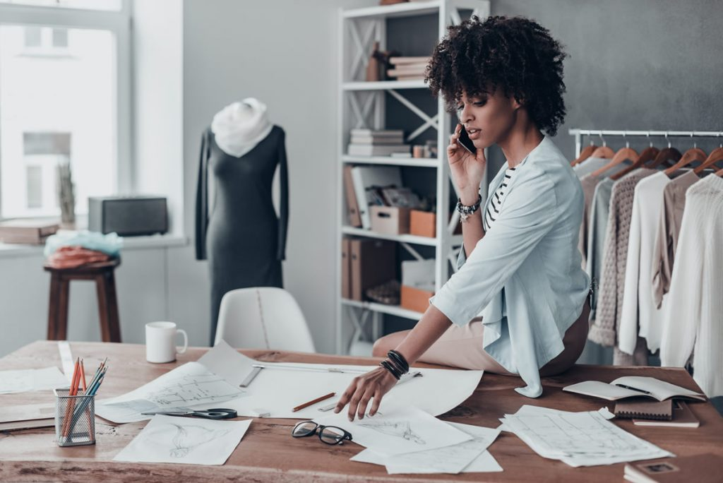 entrepreneur woman on phone discussing business