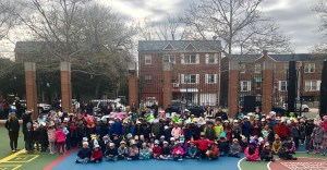 First grade showing off their hats in the school yard