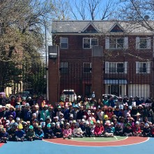 Pre-K and K students show off their hats in the school yard
