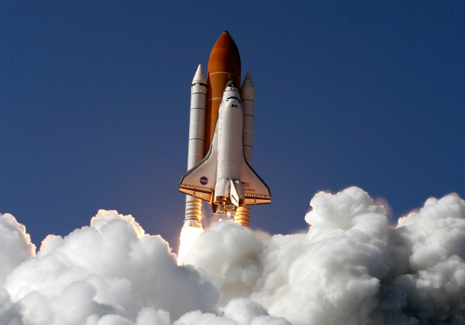 Discovery space shuttle lifts off from Kennedy Space Center.