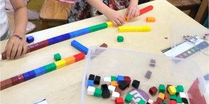 kids working with colorful counting blocks