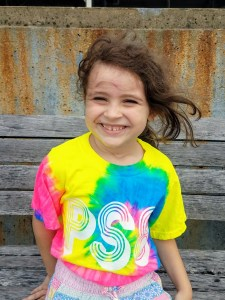 ps8 student in a tie die ps8 shirt