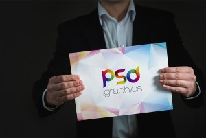 Placard in Hand Mockup Free PSD