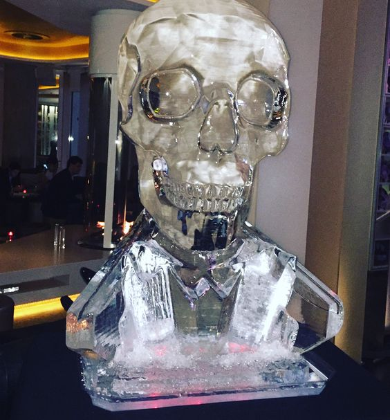 skull ice sculpture with luge