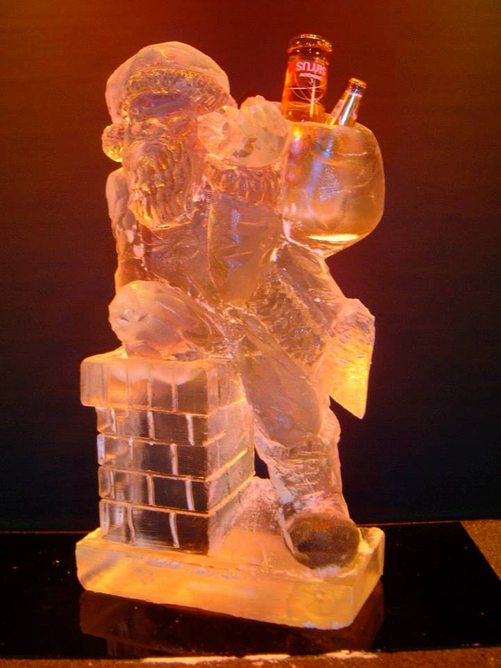 Santa down the chimney ice sculpture