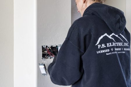 P.S. Electric, Inc. - Female Electrician Replacing Lightswitch