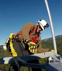 Radio operator working on tower