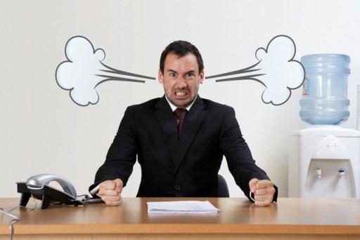 Stressed Businessman at Desk